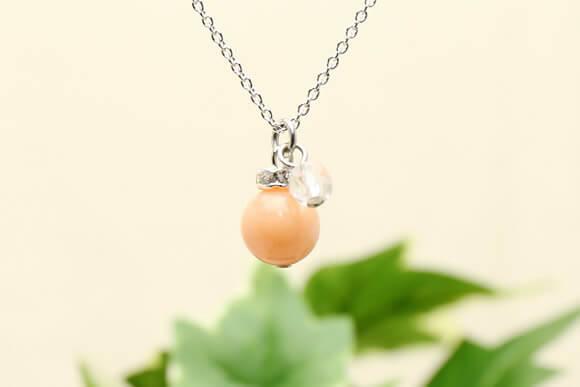 ピンクコーラル・水晶カット ネックレス (染め)